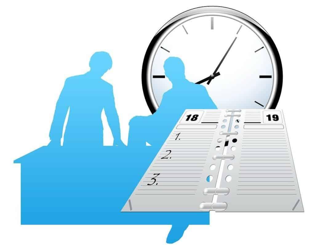 clock calendar silhouetted people