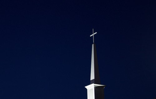 white church steeple on dark background
